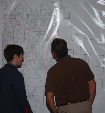 Picture of Campaign Volunteer in front of 5th District Map