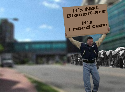 Image of man carrying a sign in front of hospital